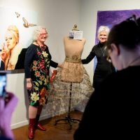 2017 Honorary Skirt, Linda Duncan, and Skirt Design Competition winner, Jane Kline, perform the Skirt Cutting Ceremony, Opening Ceremonies 2017. Photo by Brittany Paige Balser.
