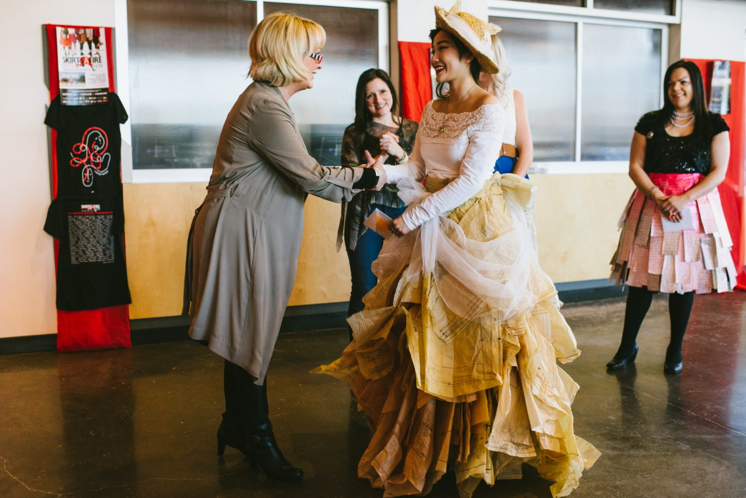 SkirtsAfire's 2020 Honorary Skirt Lesley MacDonald congratulating the winning design by Joanne Ngo. Photo by BB Collective.