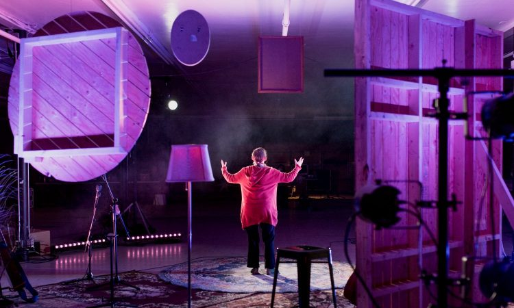 Makings of a Voice by Dana Wylie, SkirtsAfire 2021. Set, Props and Costume Design by Elise CM Jason. Lighting Design by T. Erin Gruber. Photo by April MacDonald Killins.